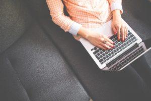 Author writing on laptop